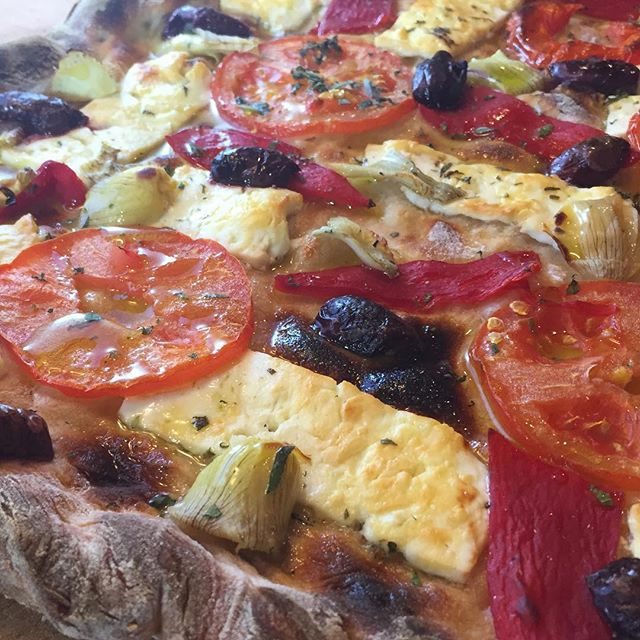 Greek Pizza: sourdough crust, tomatoes, feta, roasted peppers, artichokes, olives, olive oil, sea salt