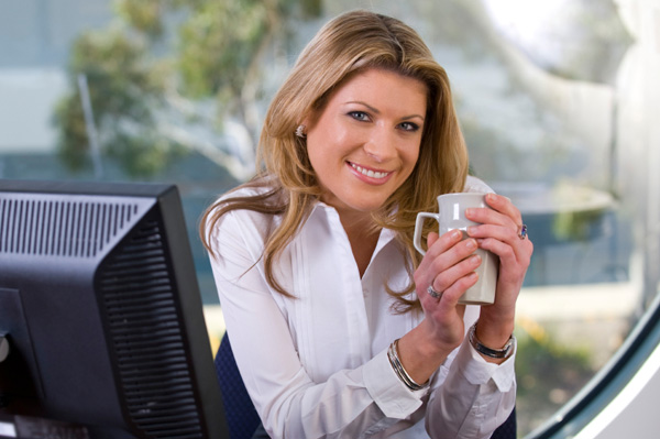 woman-drinking-coffee-at-work